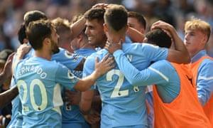 Manchester City's Rodrigo (centre) celebrates with teammates after scoring his team's fourth goal.