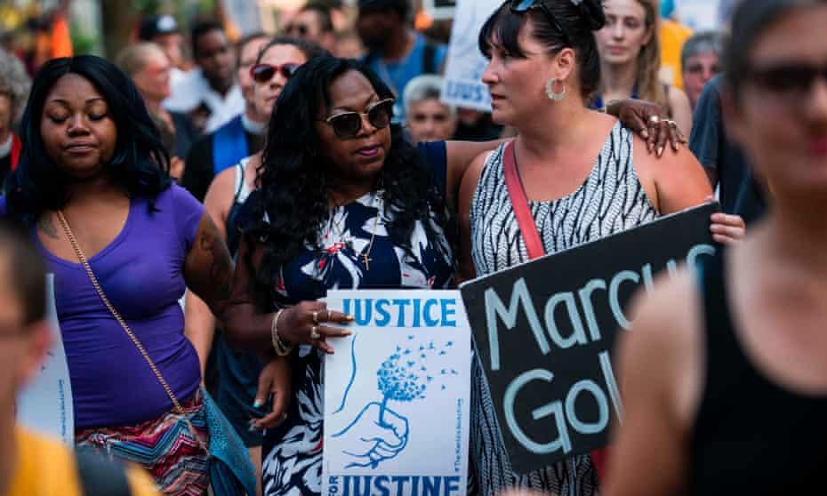 Valerie Castile, centre, mother of shooting Philando Castile, marches in memory of Justine Damond on Thursday in Minneapolis.