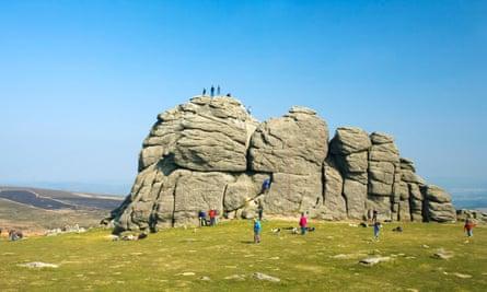 Visitors explore Dartmoor's Haytor Rocks.