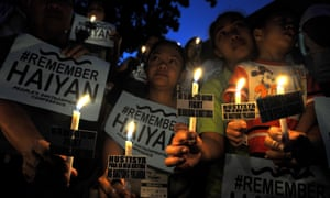 Philippine climate activists light candles in Manila last November to mark the second anniversary of typhoon Haiyan
