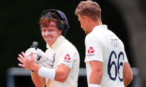 Ollie Pope congratulates teammate Joe Root for his double century, as the pair forged a partnership of 193.