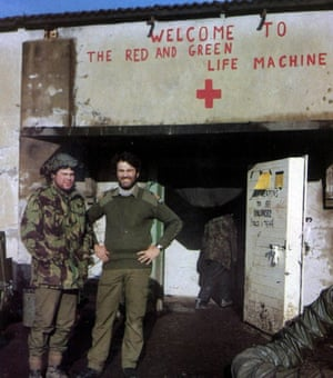 Rick Jolly, right, outside the Red and Green Life Machine, the nickname he gave to the medical post he set up in a derelict meat-processing plant in Ajax Bay on the western coast of East Falkland.