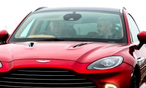 Prince Charles (left) drives the company's first SUV, the Aston Martin DBX, during his visit to its new manufacturing plant in St Athan, Wales.