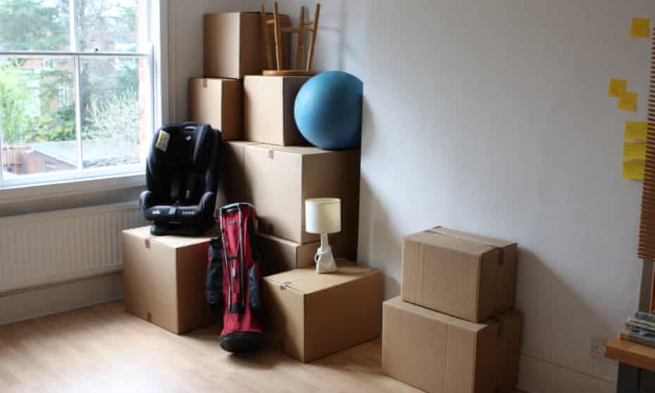 Storage boxes and stored items in a room.