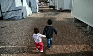 Two child refugees at a camp outside of Athens
