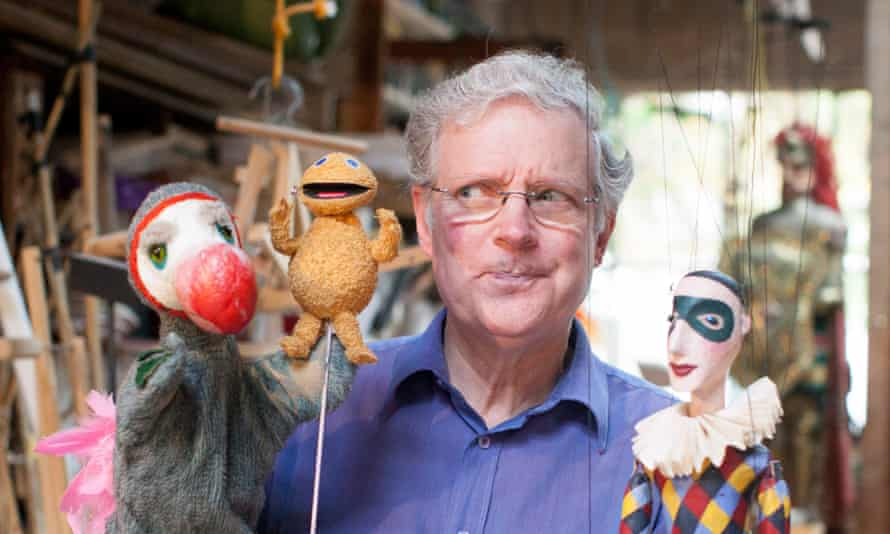 Ronnie Le Drew with a miniature Zippy and other puppets at the Little Angel theatre, London.