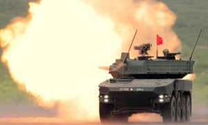 A Japanese mobile combat vehicle opens fire