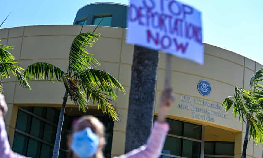 Demonstrators protest outside the US Citizenship and Immigration Service office in Miami, on February 20, 2021, demanding that the administration of US President Joe Biden cease deporting Haitian immigrants back to Haiti.