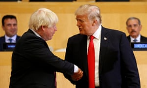 Boris Johnson shakes hands with Donald Trump.