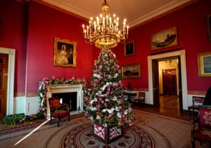 A Christmas tree adorns the red room