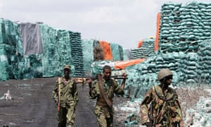 Kenya Defence Forces at a charcoal depository formerly under the control of al-Shabaab militants.