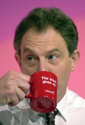 Drinks can only get better: Tony Blair swigs from a mug bearing a Labour slogan in 2001