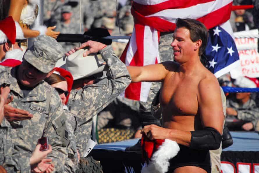 JBL gives his signature cowboy hat to a service member in Iraq.