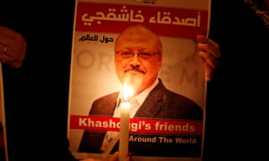 A demonstrator holds a poster with a picture of Saudi journalist Jamal Khashoggi outside the Saudi Arabia consulate in Istanbul, Turkey, on October 2018.