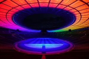 The Olympic Stadium is illuminated in rainbow colours