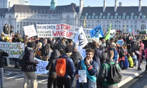 Demonstrators gather on on November 17 on Westminster Bridge in London for a protest called by Extinction Rebellion climate protest group to raise awareness of the dangers posed by climate change.