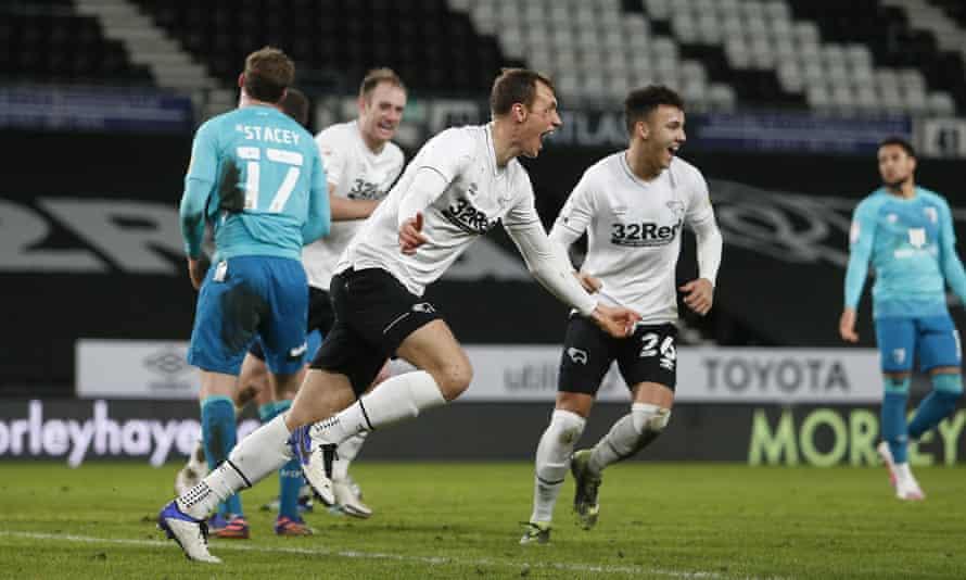 Krystian Bielik celebrates scoring Derby's winner against Bournemouth, not long after sustaining a nasty head injury.