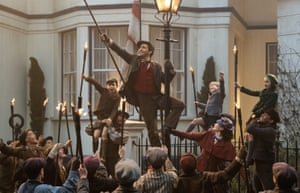 Lin-Manuel Miranda, centre, aslovable lamplighter Jack in Mary Poppins Returns