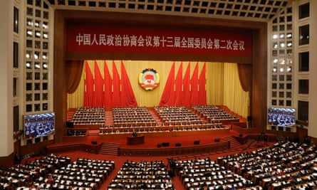 Delegates attend the opening session of 13th CPPCC National Committee in Beijing, China.