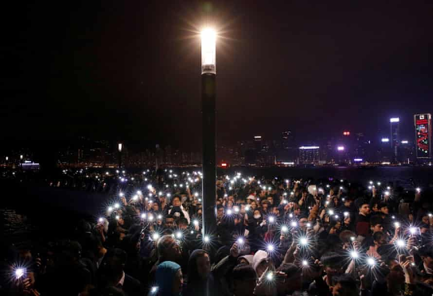 Demonstrators light up their phones to mark the new year in Hong Kong.