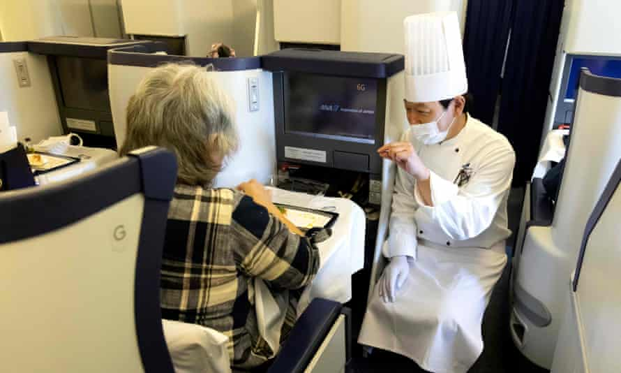 The chef speaks with a customer on a parked All Nippon Airways plane at Haneda airport in Tokyo.