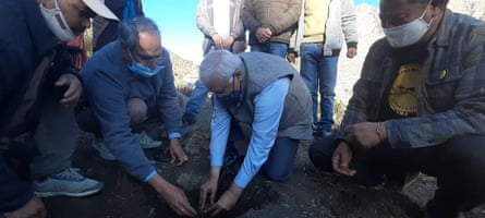 Dr Sanjay Kumar and other scientists from the Council of Scientific and Industrial Research plant the first hing saplings in Kwaring village.