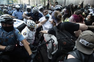 Police and protesters clash on 30 May in Philadelphia, during a demonstration over the death of George Floyd.