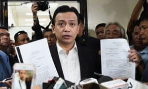 Senator Antonio Trillanes holds court documents during a press conference at the Senate in Manila