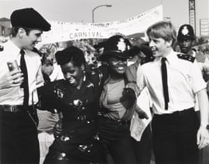 Police officers get in the carnival spirit in Notting Hill in the 1980s.