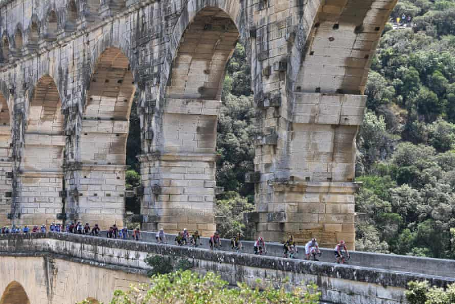 Cyclists cross the Pont du Gard during the sixteenth stage around Nimes.