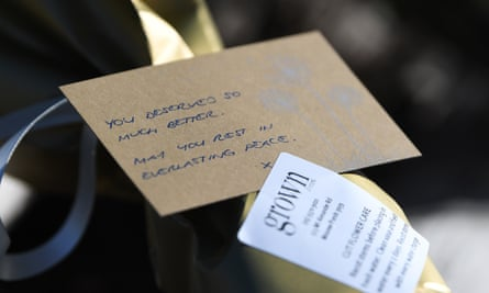 A message on a bouquet of flowers laid at the site where Herron's body was found in Royal Park