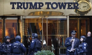 Members of the New York police department's counter-terrorism unit guard Trump Tower, a hive of courtiers vying for the president-elect's attention.