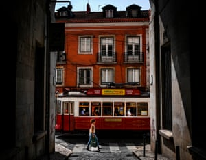 A tram passes by in the Bairro Alto neighbourhood of Lisbon, 22 September
