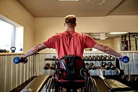 Joseph Dewey lifting weights at home as part of his recovery.