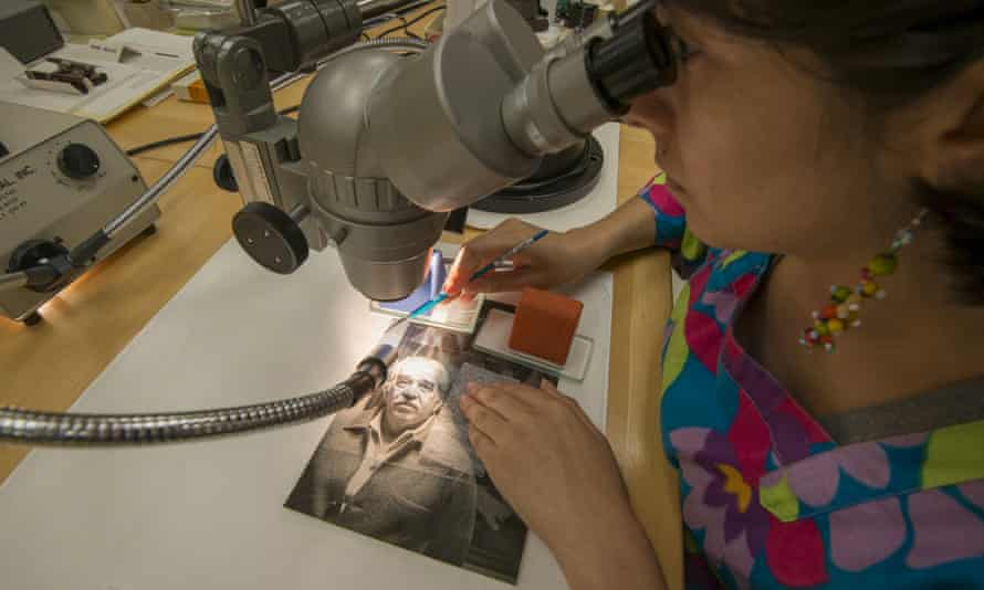A conservator repairs a crack in the gelatin emulsion layer of the photograph of Gabriel García Márquez at the Harry Ransom Center in Austin, Texas.