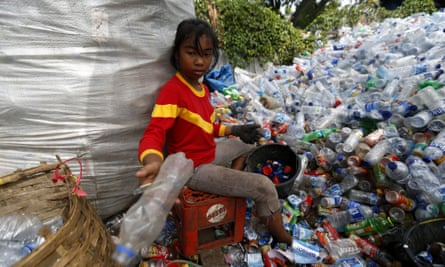 A girl recycles plastic bottles in Indonesia