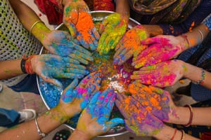 A group of girls cover their hands in coloured paint in Pushkar, a town bordering the Thar Desert in the north-eastern state of Rajasthan