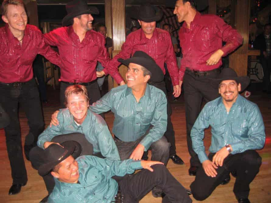 Rick Dominguez, back row, second from left, was part of the dance group LA Wranglers that performed at Oil Can Harry's in 2012. The bar closed permanently in January.