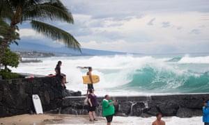 Surfers wait for an opportunity to jump into Kailua Bay, Kailua Kona.