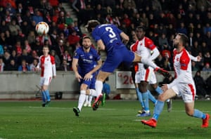 Chelsea's Marcos Alonso power a header into the corner.