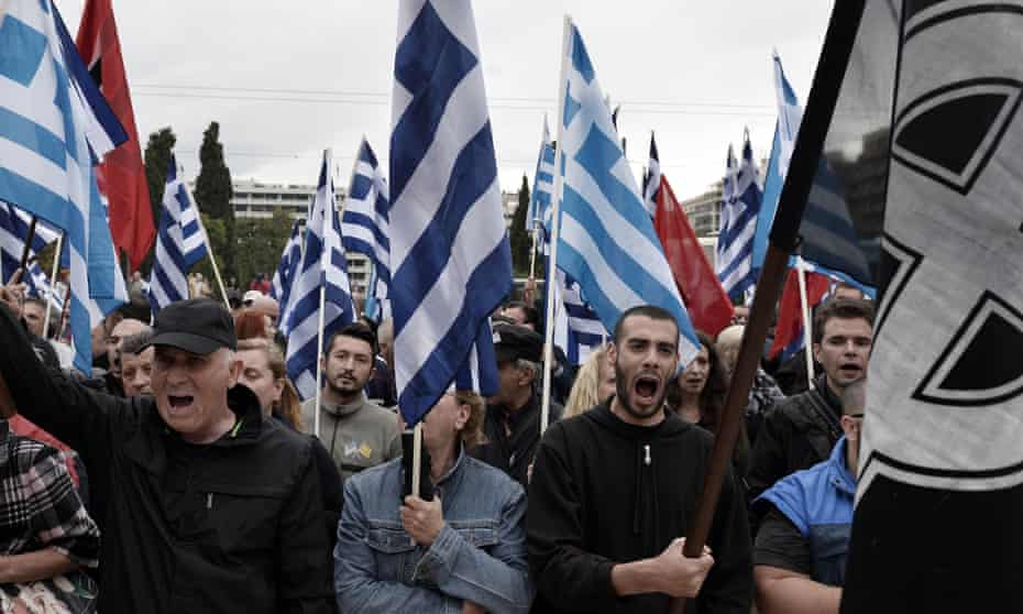 Supporters of Golden Dawn protest outside the Greek parliament in Athens. After a police crackdown on the party's members, it was thought public support would begin to wane.
