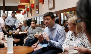 Andy Burnham talking with Labour members in Stockport.