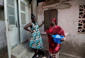 Khadjou chats to her mother Koune Ba outside their house in Ngor