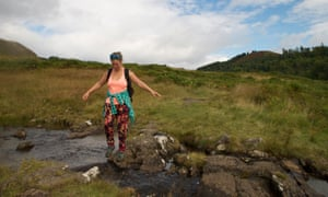 The writer's friend crosses a burn below the Menteith Hills.