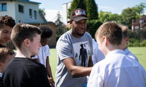 Tanayah Sam Chance to ShineFor Guardian Labs. Feature on a Chance to Shine session at St.Edmund Campion School in Birmingham where ex gang member Tanayah Sam talks at a workshop to pupils about the perils of gang culture and then partake in a game of cricket. Pictured is Tanayah Sam with year 8/10 pupils at the cricket session. Photo by Fabio De Paola