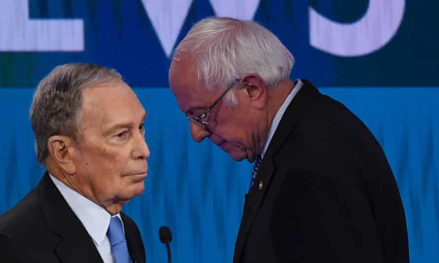 Mike Bloomberg and Bernie Sanders speak during a break in the ninth Democratic primary debate of the 2020 presidential campaign season in Las Vegas.