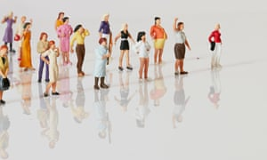 A group of toy figures of women