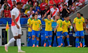 Arthur and Everton enjoy Brazil's victory over Peru in the Copa América final.