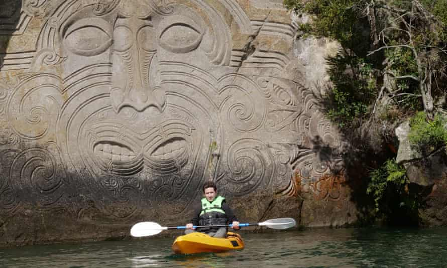 Historian James Fox in front of a 14m-high carving of the Polynesian navigator Ngatoro-i-rangi by Lake Taupo, New Zealand.