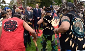Governor general David Johnston accompanies Prince William, the Duke of Cambridge, as they watch First Nations traditional dancers in front of the provincial legislature in Victoria, British Columbia.